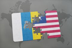 Puzzle with the national flag of canary islands and liberia on a world map background. 3D illustration Stock Photos