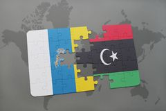 Puzzle with the national flag of canary islands and libya on a world map background. 3D illustration Stock Image