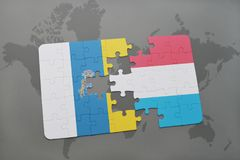 puzzle with the national flag of canary islands and luxembourg on a world map background. Royalty Free Stock Photography