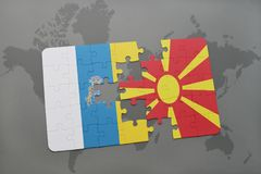 puzzle with the national flag of canary islands and macedonia on a world map background. Royalty Free Stock Image