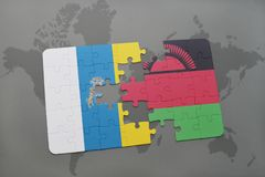 Puzzle with the national flag of canary islands and malawi on a world map background. 3D illustration Stock Photos