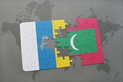 Puzzle with the national flag of canary islands and maldives on a world map background. 3D illustration Stock Photos