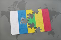 Puzzle with the national flag of canary islands and mali on a world map background. 3D illustration Royalty Free Stock Image