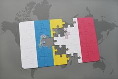Puzzle with the national flag of canary islands and malta on a world map background. Stock Photography