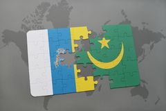 Puzzle with the national flag of canary islands and mauritania on a world map background. 3D illustration Stock Images
