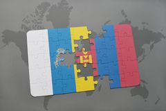 Puzzle with the national flag of canary islands and mongolia on a world map background. 3D illustration Stock Images