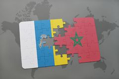 Puzzle with the national flag of canary islands and morocco on a world map background. 3D illustration Stock Photo