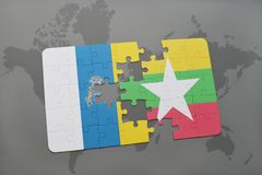 Puzzle with the national flag of canary islands and myanmar on a world map background. 3D illustration Royalty Free Stock Photo