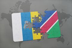 Puzzle with the national flag of canary islands and namibia on a world map background. 3D illustration Royalty Free Stock Images