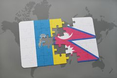 Puzzle with the national flag of canary islands and nepal on a world map background. 3D illustration Royalty Free Stock Images