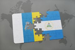 Puzzle with the national flag of canary islands and nicaragua on a world map background. 3D illustration Stock Photography