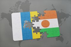 Puzzle with the national flag of canary islands and niger on a world map background. 3D illustration Royalty Free Stock Photo