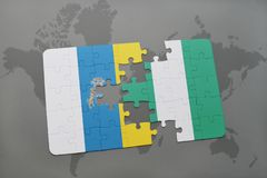 Puzzle with the national flag of canary islands and nigeria on a world map background. 3D illustration Royalty Free Stock Photography