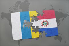 Puzzle with the national flag of canary islands and paraguay on a world map background. 3D illustration Royalty Free Stock Photography
