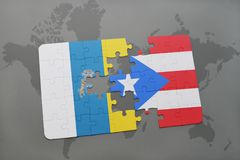 Puzzle with the national flag of canary islands and puerto rico on a world map background. 3D illustration Stock Image