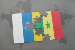 Puzzle with the national flag of canary islands and senegal on a world map background. 3D illustration Royalty Free Stock Images
