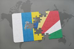 Puzzle with the national flag of canary islands and seychelles on a world map background. 3D illustration Royalty Free Stock Photography