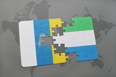Puzzle with the national flag of canary islands and sierra leone on a world map background. 3D illustration Stock Images
