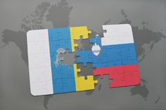 Puzzle with the national flag of canary islands and slovenia on a world map background. 3D illustration royalty free stock images