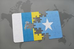 Puzzle with the national flag of canary islands and somalia on a world map background. 3D illustration Stock Photos