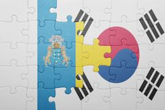 Puzzle with the national flag of canary islands and south korea. Concept stock photos