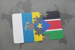 Puzzle with the national flag of canary islands and south sudan on a world map background. 3D illustration Stock Photography