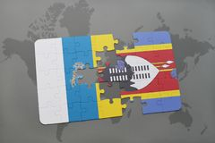 Puzzle with the national flag of canary islands and swaziland on a world map background. 3D illustration Stock Image