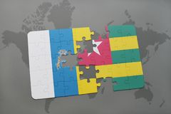Puzzle with the national flag of canary islands and togo on a world map background. 3D illustration Stock Photos