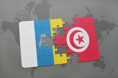 Puzzle with the national flag of canary islands and tunisia on a world map background. 3D illustration Stock Photos