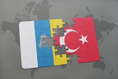 Puzzle with the national flag of canary islands and turkey on a world map background. 3D illustration royalty free stock photos