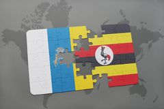 Puzzle with the national flag of canary islands and uganda on a world map background. 3D illustration stock photo