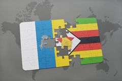 Puzzle with the national flag of canary islands and zimbabwe on a world map background. 3D illustration Stock Photos