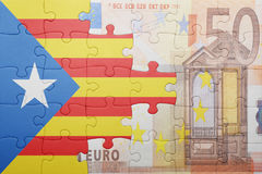 Puzzle with the national flag of catalonia and euro banknote. Concept Royalty Free Stock Images