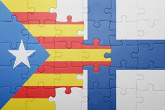 Puzzle with the national flag of catalonia and finland Royalty Free Stock Photos