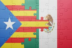 Puzzle with the national flag of catalonia and mexico. Concept royalty free stock image