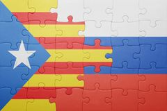 Puzzle with the national flag of catalonia and russia. Concept Stock Photography