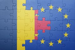 Puzzle with the national flag of chad and european union Stock Photos