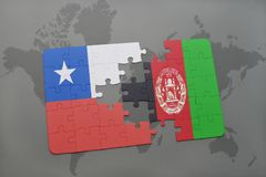 Puzzle with the national flag of chile and afghanistan on a world map background. Stock Photography
