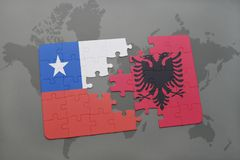 Puzzle with the national flag of chile and albania on a world map background. Royalty Free Stock Images