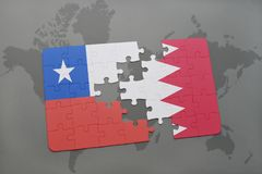 Puzzle with the national flag of chile and bahrain on a world map background. Royalty Free Stock Images