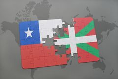 Puzzle with the national flag of chile and basque country on a world map background. Royalty Free Stock Images