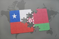 Puzzle with the national flag of chile and belarus on a world map background. Royalty Free Stock Images