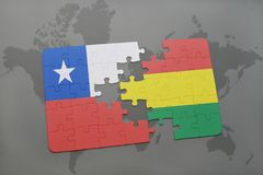 Puzzle with the national flag of chile and bolivia on a world map background. Stock Photos