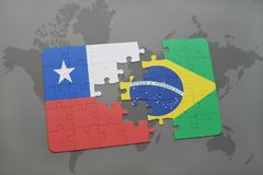 puzzle with the national flag of chile and brazil on a world map background. Stock Photo