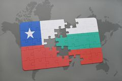 Puzzle with the national flag of chile and bulgaria on a world map background. Stock Image