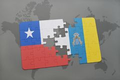 Puzzle with the national flag of chile and canary islands on a world map background. Royalty Free Stock Images