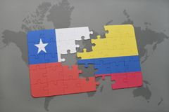puzzle with the national flag of chile and colombia on a world map background. Royalty Free Stock Images