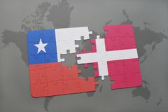 Puzzle with the national flag of chile and denmark on a world map background. Stock Images