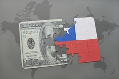 Puzzle with the national flag of chile and dollar banknote on a world map background. Stock Photo