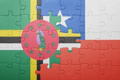 Puzzle with the national flag of chile and dominica. Concept stock photo